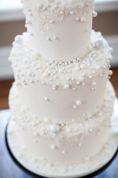 "cake ""pearls"" in various sizes, photo by Alexis June Weddings http://ruffledblog.com/spring-neon-wedding-inspiration #weddingcake #cakes"
