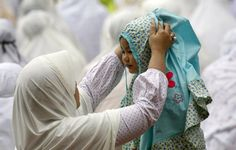 15. Jakarta, Indonesia, 2009.Supri Supri / Reuters / Via Reuters A mother adjusts her daughter's headscarf before a prayer on the occasion of Eid al-Adha at Jakarta's largest mosque, the Istiqlal. Indonesia, the world's most populous Muslim nation, celebrates Eid al-Adha to mark the end of the Haj by slaughtering goats and cows and distributing the meat to the poor.