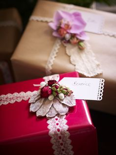 A pile of beautifully wrapped #christmas presents with pretty floral gift tags