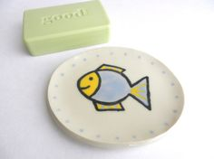 This cute soap dish with fish was hand build out of a slab of white clay. I have hand painted the picture of fish on it and colored it with rich yellow and soft blue glaze.  I have made it for soap but could be used for earrings, rings, clips, hair ties....
