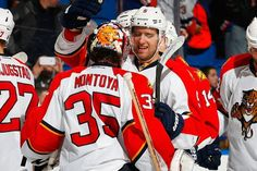 UNIONDALE, NY - FEBRUARY 03: Al Montoya #35 of the Florida Panthers is congratulated by teammate Aaron Ekblad #5 after defeating the New York Islanders at Nassau Veterans Memorial Coliseum on February 3, 2015 in Uniondale, New York. The Florida Panthers defeated the New York Islanders 4-2. (Photo by Mike Stobe/NHLI via Getty Images)