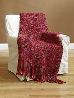Finish this lovely throw in only six hours using Size 50 Speed Stix needles. (Lion Brand Yarn)