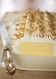 Passion Fruit Baked Alaska ~ I always wondered how to do Baked Alaska. Hrm. This might be one for a very special occasion.
