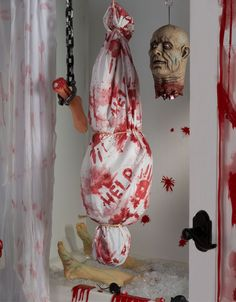 Zombie props for a gruesome and gory zombie party! Find more zombie party ideas at blog.partydelights.co.uk.