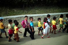 Children walk home after school in a rural area near the North Korean special economic zone of Razon. (Carlos Barria/Reuters