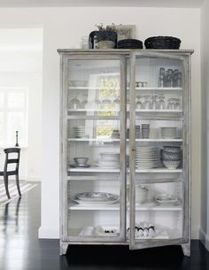Glass kitchen cabinet. Beautiful but not practical with a baby and toddler