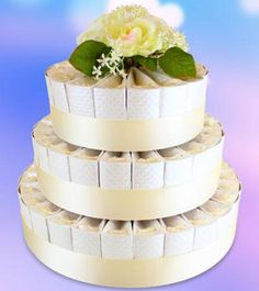 White Favor Cake - Feature boxes of wedding favors for your guests in this elegant cake-shaped display. Wedding Cake Boxes, Box Cake, Wedding Tokens, Wedding Favours, Wedding Favor Inspiration, Wedding Ideas, Do It Yourself Wedding, Paper Cake, Elegant Cakes
