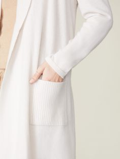 Woven with 100%, 10gg cashmere, our cashmere robe is unbelievably plush and warm. Featuring a belted waist, a stylish shawl collar, and pockets on each side meant to hold small items with ease, this robe is both cozy, elegant, and practical. A new addition to our best-selling cashmere collection, our cashmere robe is very appropriate for lazy weekend mornings, relaxed nights, and work-from-home days. Women's Wardrobe Essentials, Cashmere Robe, Mornings, Lazy, Shawl, Plush, Pockets, Elegant, Stylish