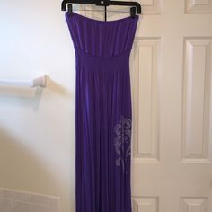 Strapless Maxi Cute strapless maxi dress that gets you ready for summer. Purple with silver appliqué on left. Great condition from smoke free home. Size M. Cristina Love Dresses Strapless