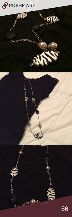 """Fun Black and white necklace Find black and white accent necklace. Costume jewelry. 38"""" long. Please ask for additional measurements or information if needed before purchasing. Jewelry Necklaces"""