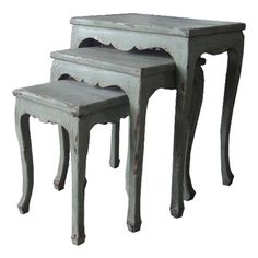 Set of three distressed wood nesting tables with scalloped aprons    Product: Small, medium and large nesting tableConstr...