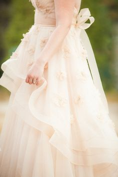 That dress. Oh that dress. I would be lying if I said I didn't want to slip my toes in it and twirl around in that blush beauty. Can you blame me really? It's stunning, and the Bride that did