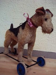 Antique dog ride on toy, Steiff. The Victorian Dog Parlour and a Victorian dog on wheels. #AmazingSpaces #Victorian #DogOnWheels http://mycoolhomepage.com/victorian-dog-grooming-parlour-and-my-amazing-spaces-dog-on-wheels/