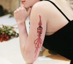 Red norigae with lotus. The design moving with the flow of body. Girly Tattoos, Mini Tattoos, Ribbon Tattoos, Tattoos Skull, Feminine Tattoos, Baby Tattoos, Friend Tattoos, Foot Tattoos, Body Art Tattoos