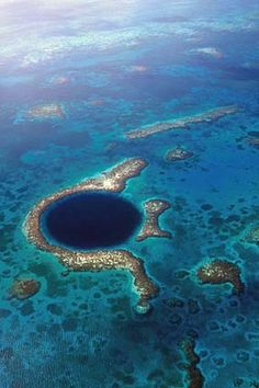 The Great Blue Hole in Belize. The Great Blue Hole s a massive submarine sinkhole near the coast of Belize. It is found near the center of Lighthouse Reef. The hole is 984 feet m) across and 407 feet m) deep. It is a UNESCO World Heritage Site. Belize Vacations, Belize Travel, Dream Vacations, Vacation Spots, Belize Honeymoon, Romantic Vacations, Belize Tourism, Italy Vacation, Honeymoon Destinations