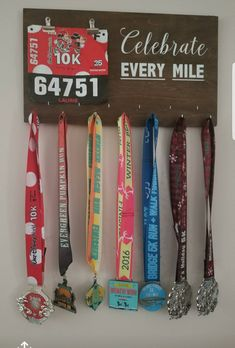 Perfect medal holder sign! Celebrate every mile. #quote #sign #farmhousesign #homedecor #medalholder #medals #runners #run #health #celebrateeverymile #medaldisplay #display #celebrate #woodsign #custom #homedecor #entryway #running