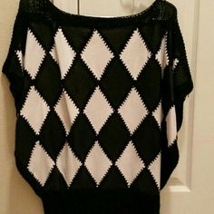 80's Silk & Leather Patchwork Sweater Black and white silk and leather patchwork sweater, banded bottom, great paired with jeans or a leather skirt. Fits a 10-12. Tops Blouses