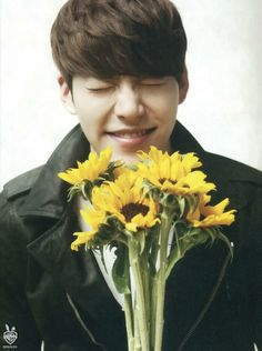 Yes. I'm jumping on the bandwagon and pinning Kim woo bin. Guy is wearing a leather jacket and holding flowers.