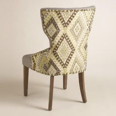$149.99 sale at World Market. With a curvy keyhole silhouette and a pop of bold color, our dining chair brings bright style to the table. Upholstered with gray tufted linen on one side and a green woven geometric print on the back, it's framed with nail heads for a classic touch.