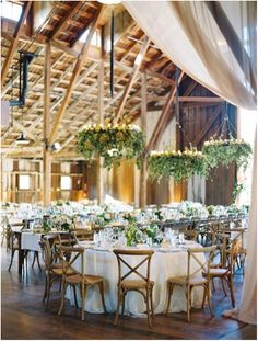 white and greenery wedding reception room with hanging greenery http://www.itgirlweddings.com/blog/7-new-wedding-trends