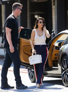 """Make first place like Kourtney in Gucci joggers  Click """"Visit"""" to buy #DailyMail"""