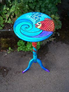 Painted fish table. I painted its tail wrapped around the pedestal.
