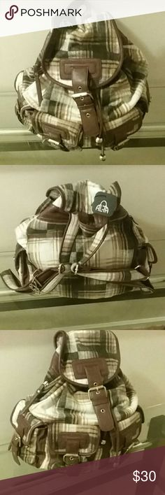Backpack NWT Alfa Backpack. Soft Brown plaid flannel. 4 front storage pockets with buckles. Inside storage pockets. Lined. Back adjustable straps with front buckle snap closure. Bundle up in my closet and save! Alfa Bags Backpacks