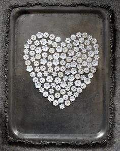 White Button Heart, just take old buttons and hot clue to a silver or silver plated tray or any pretty old tray you have, then hang!