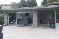 This aluminium Tri-slider combines an entertainment room, with a side canopy for a BBQ area, it also included a serving hatch to kitchen. (search for 5223 for more details) Garden Office Shed, Garden Bar Shed, Summer House Garden, Garden Log Cabins, Garden Lodge, Kitchen Window Bar, Summer House Interiors, Outdoor Bbq Kitchen, Timber Buildings