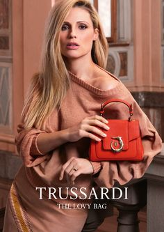 Playful, celebratory and colorful: The iconic LOVY Bag is the protagonist alongside Michelle Hunziker in LOVY's new campaign for Spring/Summer 2017. Photo: Fabio Leidi #LOVYBag #LOVYLover #Trussardi