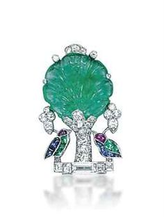 AN ART DECO MULTI-GEM AND DIAMOND BROOCH, BY CARTIER Designed as two buff-top cabochon sapphire, emerald and ruby birds under a carved emerald tree with diamond detail, trunk and base.
