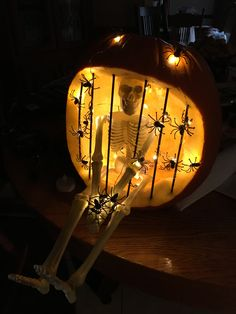 Skeleton in jail carved pumpkin lit with battery operated LED spider lights. Painted skewers black for prison bars. Skeleton in jail carved pumpkin lit with battery operated LED spider lights. Painted skewers black for prison bars. Halloween Pumpkin Designs, Diy Halloween Decorations, Halloween Pumpkins, Easy Pumpkin Carving, Carving Pumpkins, Holidays Halloween, Halloween Crafts, Halloween Cubicle, Halloween Stuff