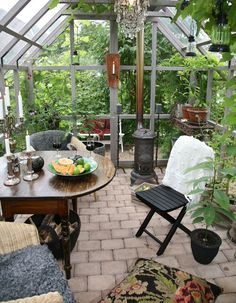 Beautiful conservatory! I'd love to lunch there. #conservatorygreenhouse