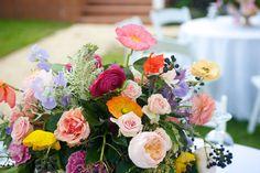 Margot Blair Floral collab with The Byrd Collective | Ashley Garmon Photography | Bird Dog Wedding | Green Pastures | Austin, TX | #peonies #ranunculus #tulips #juliette garden roses #privet #pink #yellow #lavender. Garden party wedding flowers.