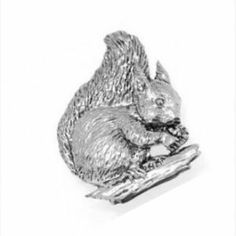Pewter Pin Badge Animal Squirrel by Danetre Gifts. $6.99. Quality Lead Free English Pewter. Supplied in a lovely black velvet gift bag, cellophane bagged to protect from weather on its journey.. Measures approx 1 inch across. English Pewter, made in UK. NOT SUITABLE FOR YOUNG CHILDREN DUE TO SMALL PARTS. Comes with two clutch and pin style fittings on the back.. English made pewter jewellery and decorative items. A quality British made product.