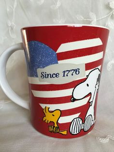 """Peanuts Patriotic Snoopy - Ceramic 15 oz Coffee Cup/Mug. Mug reads """" Since 1776"""". Red colored mug with a heart shaped US flag. Colors: Red, White, Blue, Yellow, Black.   eBay!"""