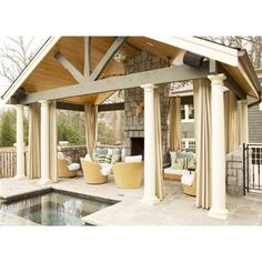 SOmething like this housing an outdoor kitchen attached to the pool or entertainment/grass area?
