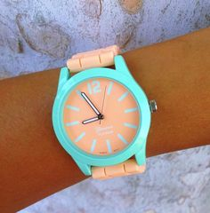 Perfect melon watch featuring light orange silicone straps and mint watch face rim. *These watches have adjustable sizing*