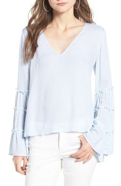 Free shipping and returns on BP. Stripe Bell Sleeve Blouse at Nordstrom.com. Playfully tiered bell sleeves add breezy volume to this must-have spring top patterned with classic blue-and-white stripes.