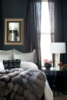 Another easy, winter decor tip is to replace your light curtains with black, blue or gray ones in heavier fabrics. This brings warmth both visually and literally.  Via Rue Magazine