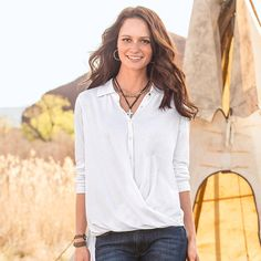 """SUBTLE TWIST TOP--In luxuriously soft knit, our button placket top boasts a drape and twist detail hem. Shirttail back hem, neckline gathers for feminine grace. Cotton/modal. Machine wash. Imported. Exclusive. Sizes XS (2), S (4 to 6), M (8 to 10), L (12 to 14), XL (16). Front approx. 26""""L, back approx. 31""""L."""