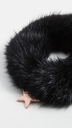 Cannot be shipped outside the USA Fur: Dyed mink, from Denmark Elasticized hair tie Rose-toned charm detail Professional fur clean Imported, China Fingerless Mittens, Mink Fur, Staple Pieces, China Fashion, Daily Look, Hair Ties, Scrunchies, Easy Hairstyles, Inventions
