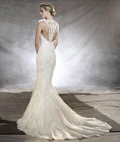 Pronovias Ostadar lace fit and flare gown with delicate straps and a stunning racer back. Please call either store for pricing and appointment details.