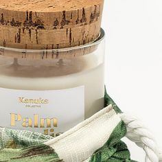Kanuka Collective Palm Paradise Soy Candle //With bottom notes of light musk, white tea and sandalwood coupled with classic coconut. You'll be transported to the tropics the second you remove our natural cork snuff lid. Made and hand poured in New Zealand. Shop - www.kanuka.co #tropics #soy #candle #drawstring #bag #palm #print #coconut #sandalwood #palmparadise #nzmade