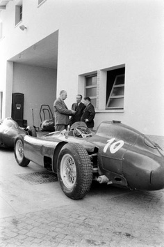 Enzo Ferrari behind his factory.