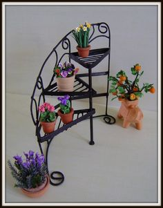 One inch scale Wrought Iron Stand for Plants... 65.00, via Etsy.
