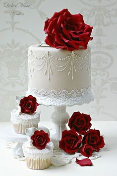 Red Roses on White Wedding Cake and Cupcakes