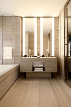 Bathroom: beautiful materials, simple lines, love the lighting at the mirrors Armani