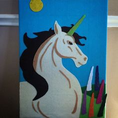 """Pin the Horn on the Unicorn"" game for Jack's Mythical Creature birthday party.  Felt on foam board."