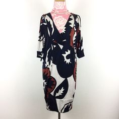 ✨DvF✨Silk tunic dress Diane Von Furstenberg silk dress. Size 4. 100% silk. Oversized tunic style fit. Great condition except for light staining throughout. The last pic shows the light red color. Someone accidentally washed it with reds. Honestly it's hard to notice and almost looks like part of the design. Price reflects condition. Diane von Furstenberg Dresses Mini